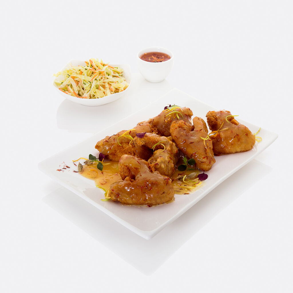 crispy chicken wings with a honey sauce by tanmia